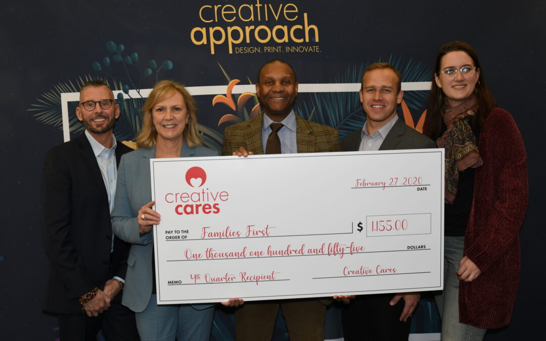Creative Cares presents check to Families First